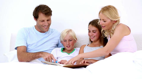 Cute family reading together Footage