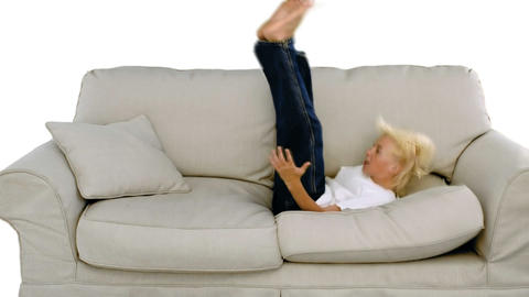 Boy jumping on the sofa on white background Footage