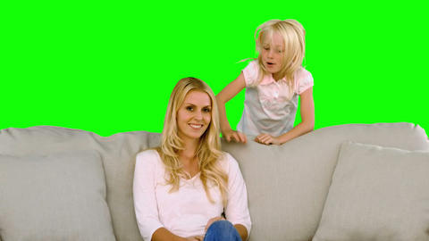Little blonde girl surprising her mother in slow m Footage