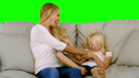 Mother tickling her daughter in slow motion Footage