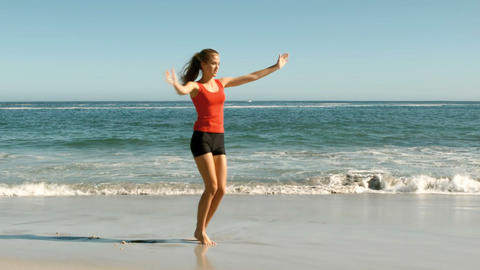 Attractive woman doing cartwheels on the beach Footage