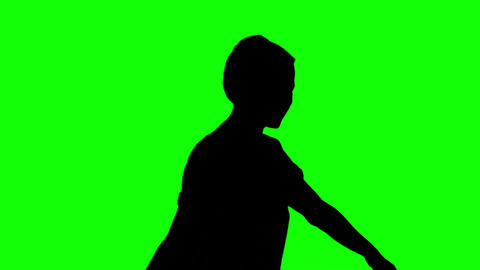 Silhouette of woman listening to music on green screen Footage