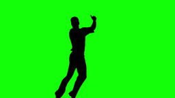 Silhouette of man jumping and giving thumb up on g Footage