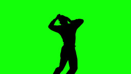 Silhouette of a man enjoying music on green screen Footage