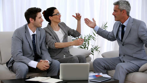 Group of business people gesturing during a meetin Footage