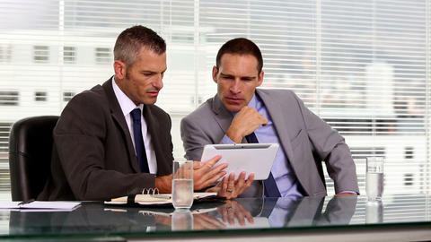 Businessmen working together on a tablet Footage