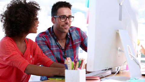 Attractive Designers Working Together On A Compute stock footage