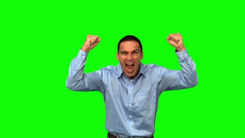 Angry businessman raising arms on green screen Live Action