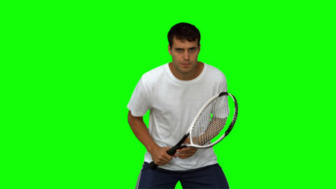 handsome man training while playing tennis on green screen Footage