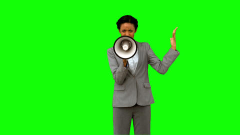 Businesswoman yelling into a megaphone on green screen Footage