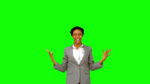Pretty businesswoman raising arms on green screen Live Action