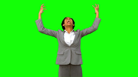 Furious businesswoman raising arms on green screen Live Action
