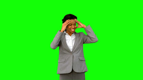 Furious businesswoman holding her head on green screen Live Action