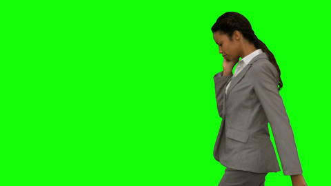 Angry woman shouting at her phone on green screen Footage