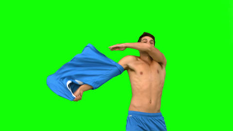 Handsome football player celebrating a goal on green screen Live Action