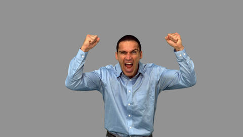 Angry businessman raising arms on grey screen Live Action