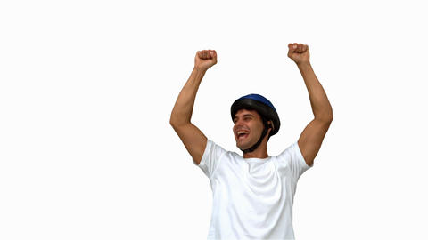 Man on his bicycle raising arms on white screen Live Action