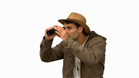 Man wearing a coat using binoculars on white screen Footage