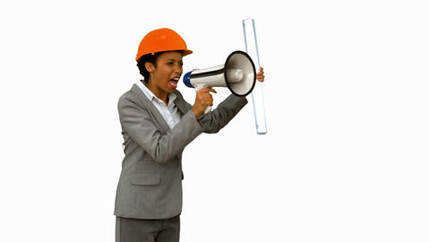 Angry architect using a megaphone on white screen in slow motion Footage