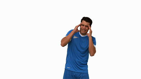 Football player suffering from headache on white screen Live Action
