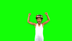 Cute girl wearing a bike helmet and raising arms on green screen Live Action