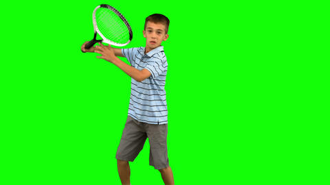 Little boy playing tennis on green screen Footage
