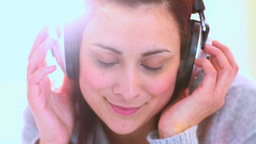 Young woman listening to music Footage