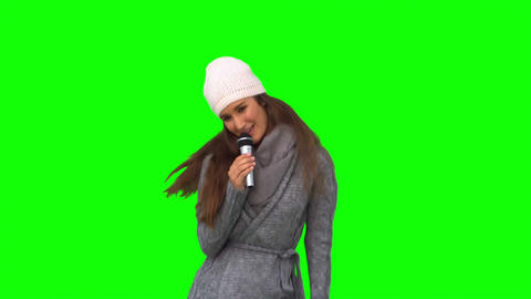 Smiling young woman singing Footage