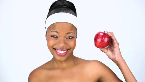 Attractive woman holding red apple Footage