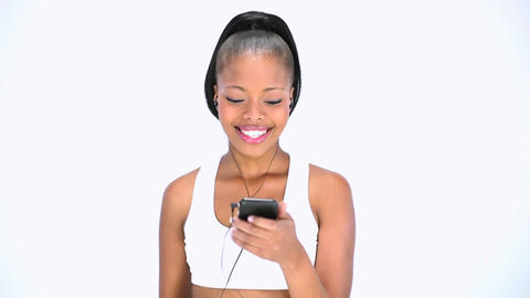 Cheerful model listening to music Footage