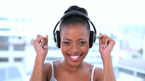 Cheerful beautiful model listening to music Footage