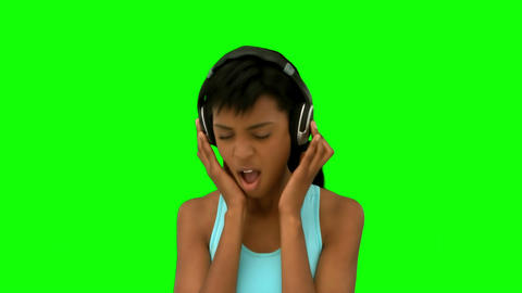 Attractive model singing while listening to music Footage