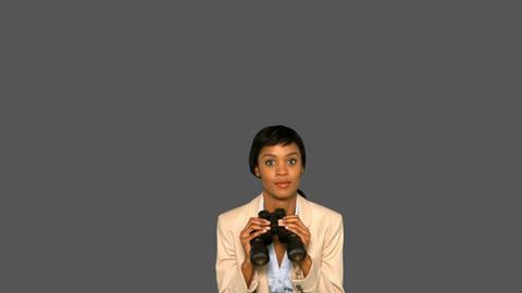Businesswoman jumping while holding binoculars Footage