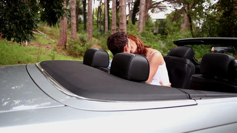 Romantic couple kissing in a car Footage
