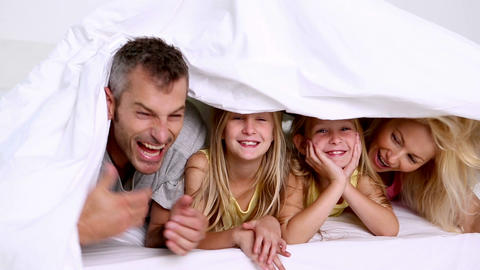 Family playing with duvet Footage