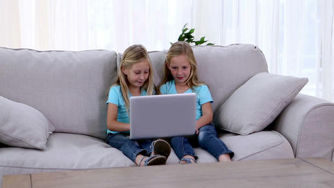 Two sisters playing with laptop Footage