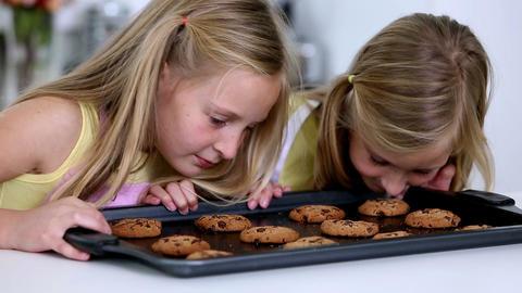 Daughter smelling cookies Footage