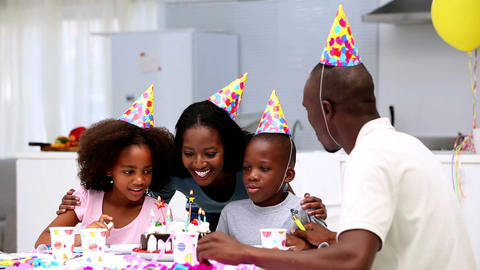 Son blowing out the candles on birthday cake Footage