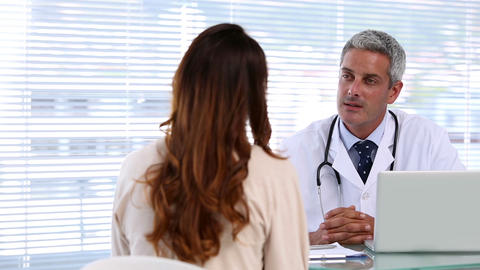 Doctor discussing with a patient Footage