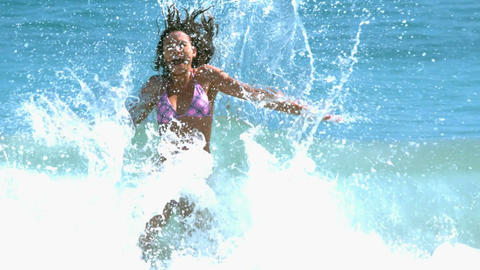 Attractive woman having fun in the waves Footage