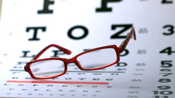 Glasses falling on eye test Footage