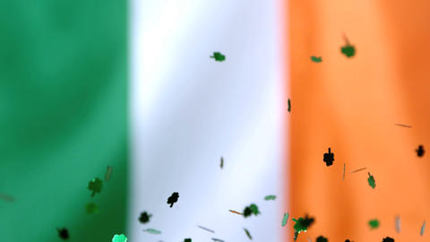 Shamrock confetti falling on irish flag 影片素材