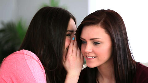 Attractive woman telling her friend a secret Footage