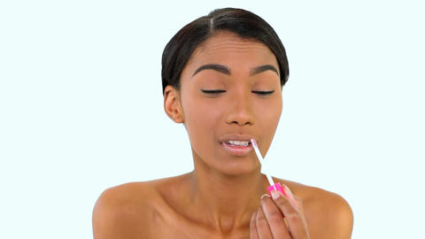 Cheerful woman posing lip gloss Live Action