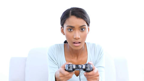 Woman playing and losing at video games Footage