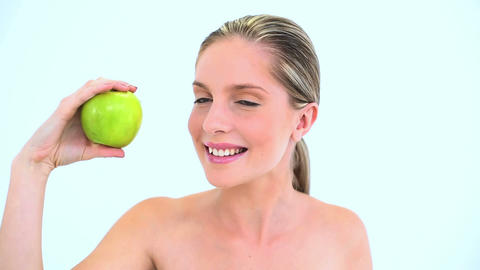 Pretty woman holding a green apple in her hand Footage