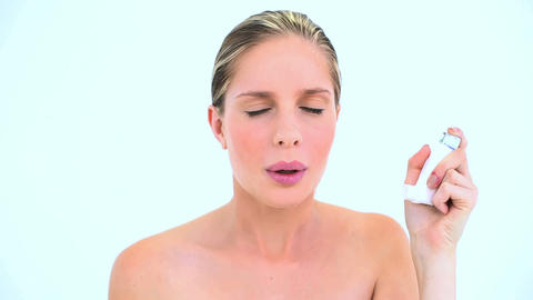 Woman holding an asthma inhaler Footage