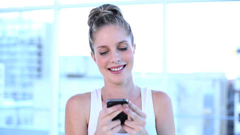 Beautiful businesswoman texting with her mobile phone Footage