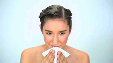 Young woman blowing her nose Footage