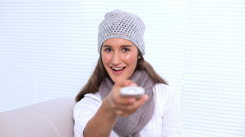 Young woman watching television and changing chann Footage